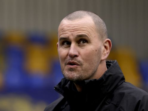 Mark Robinson is not getting carried away with AFC Wimbledon's huge win (Steven Paston/PA)