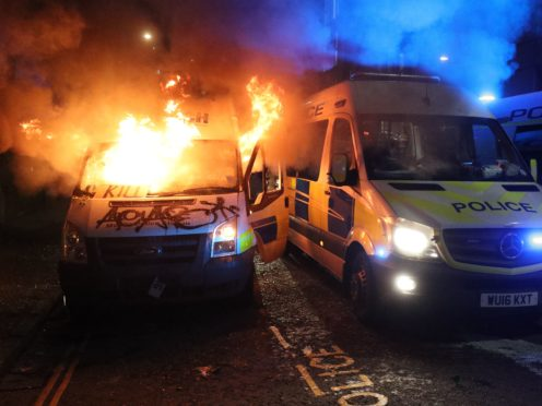 A police van was set on fire outside Bridewell police station (Andrew Matthews/PA)