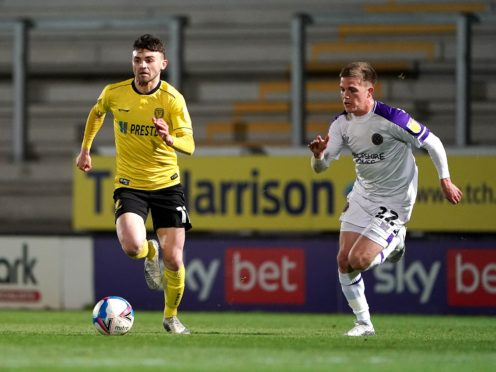 Burton's Jonny Smith (left) is unlikely to feature against Lincoln (PA)