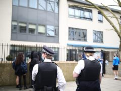 Police officers outside Pimlico Academy (Aaron Chown/PA)