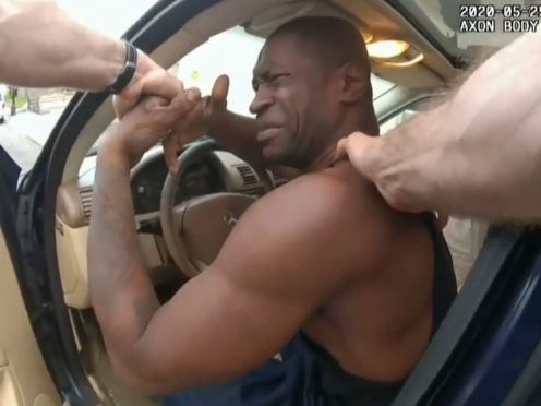 In this image from police bodycam video, police officers attempt to remove George Floyd from a vehicle on May 25, 2020 outside Cup Foods in Minneapolis (Court TV via AP, Pool)