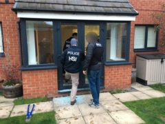 Police entering a property as part of the investigation (National Crime Agency/PA)