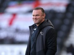 Derby manager Wayne Rooney saw his side ease their relegation worries against Luton (Bradley Collyer/PA)