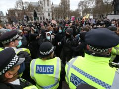 Police push back demonstrators during a Kill The Bill protest in Parliament Square on Saturday (Jonathan Brady/PA)