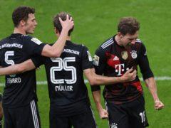 Leon Goretzka, right, celebrates his goal (Alexander Hassenstein/AP)