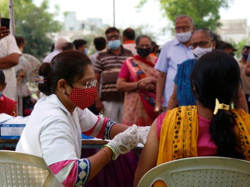 A health worker administers a vaccine in India (Ajit Solanki/AP)