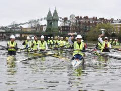A group of rowers, including former British Olympians and Oxford and Cambridge boat race competitors, taking part in a demonstration in front of Hammersmith Bridge in west London over the Government's inability to agree a repair plan for the bridge after almost two years (Hammersmith Bridge SOS/PA)