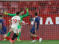 Marcos Acuna scores Sevilla's winner against Atletico Madrid (Angel Fernandez/AP)