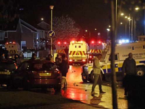 The PSNI on Northland in Carrickfergus near Belfast following sporadic outbursts of disorder (Liam McBurney/PA)