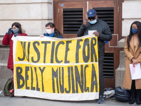Lusamba Katalay (third from left), the husband of Belly Mujinga, joins activists at a vigil at Victoria station (Dominic Lipinski/PA)