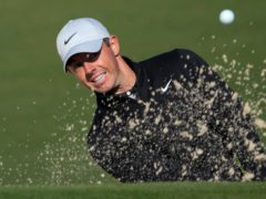 Rory McIlroy hits from a bunker on the second hole during a practice round for the 85th Masters (David J Phillip/AP)
