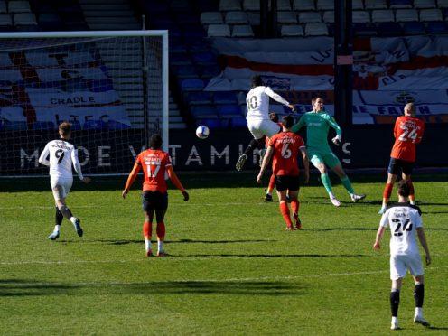 Daryl Dike scores Barnsley's second goal of the game (John Walton/PA)