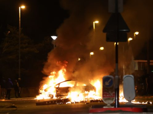 A car burns on Sperrin Road, Waterside, Londonderry (Liam McBurney/PA)
