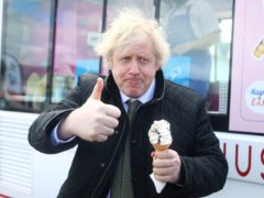 Prime Minister Boris Johnson gives a thumbs-up gesture after being served an ice cream (Tom Nicholson/PA)