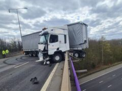 An HGV after it collided with the side of the M25 at Junction 2 (Highways England/PA)