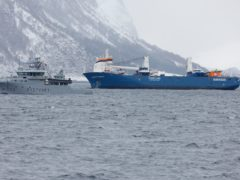 The Dutch cargo ship Eemslift Hendrika is guided to land at Alesund, Norway (Svein Ove Ekornesvag / NTB)