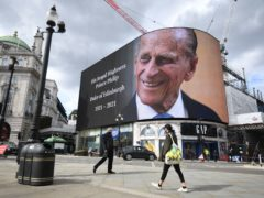 A tribute to the Duke of Edinburgh, which will be shown for 24 hours, on display at the Piccadilly Lights in central London (Kirsty O'Connor/PA)