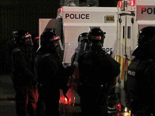 PSNI officers on North Queen Street in Belfast (PA)