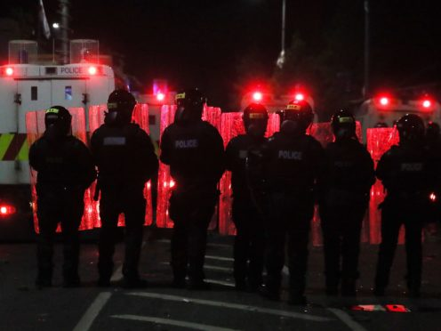 Members of the PSNI in the Tiger's Bay area of North Belfast (Brian Lawless/PA)