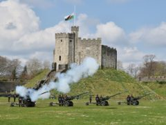 Members of the 104th Regiment Royal Artillery fire a gun salute in the grounds of Cardiff Castle (Ben Birchall/PA)