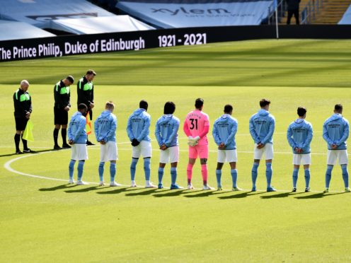 Manchester City players stand for a two-minute silence prior to kick-off against Leeds (Rui Vieira/PA)