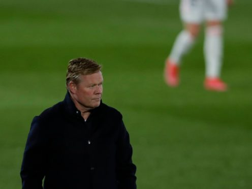 Ronald Koeman challenged the officials after the final whistle of Barcelona's defeat at Real Madrid (Manu Fernandez/AP)