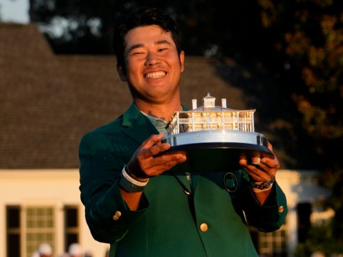 Hideki Matsuyama holds the trophy after winning the 85th Masters (David J. Phillip/AP)