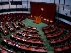 Pro-China legislators attend the first and second reading of the Improving Electoral System (Consolidated Amendments) Bill 2021 at the Legislative Council in Hong Kong (Vincent Yu/AP)