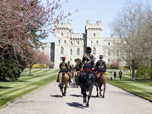 King's Troop Royal Horse Artillery make their way up The Long Walk towards Windsor Castle (Phil Noble/PA)