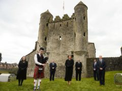 Northern Ireland's First Minister Arlene Foster, along with Deborah Erskime, Piper Aaron Elliott, Keith Elliott, Cllr Errol Thompson, Cllr Mark Buchanan and Cllr Paul Robinson, observes a minute's silence to mark the funeral of the Duke of Edinburgh at Enniskillen Castle, Co Fermanagh (Mark Marlow/PA)