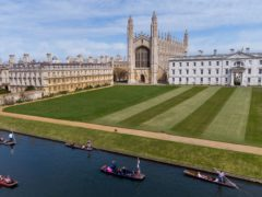People enjoy a punt tour past King's College on the River Cam in Cambridge (PA)