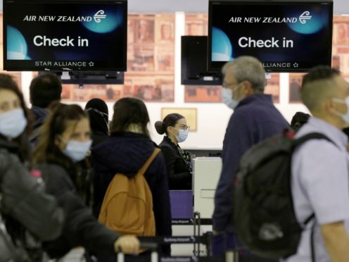 Passengers prepare at Sydney Airport to catch a flight to New Zealand as the much-anticipated travel bubble between Australia and New Zealand opens (Rick Rycroft/AP)