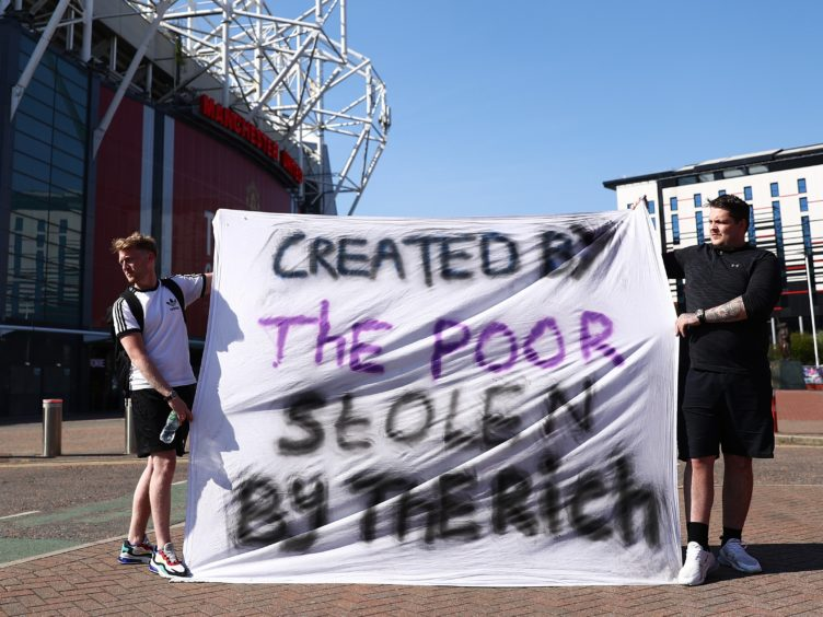 Football fans opposing the European Super League proposals outside Old Trafford in Manchester (Tim Markland/PA)