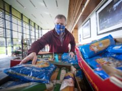 Scottish Liberal Democrat leader Willie Rennie visits a food bank at Gogarburn Conference Centre, Edinburgh, as he sets out plans for adult social care during campaigning for the Scottish Parliamentary election (Jane Barlow/PA)