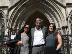 Former post office worker Vijay Parekh from Willesden, with his wife Gita (left) and daughter Bhavisha (Yui Mok/PA)