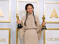 Chloe Zhao with the best picture and best director Oscars for Nomadland. The ceremony's TV viewing audience dropped to a new low this year (Chris Pizzello/AP)