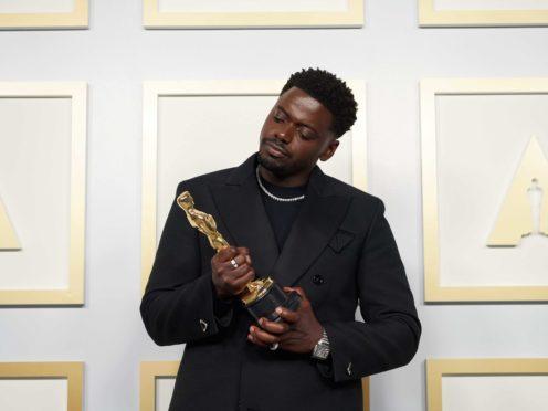Kaluuya with his award (PA)
