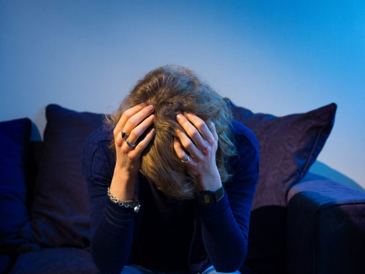 A woman showing signs of depression (Dominic Lipinski/PA)