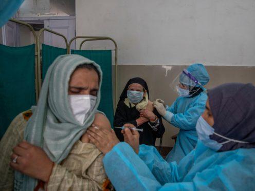 Kashmiri women receive Covishield vaccine for Covid-19 at a primary health center in Srinagar, Indian controlled Kashmir (Dar Yasin/AP)