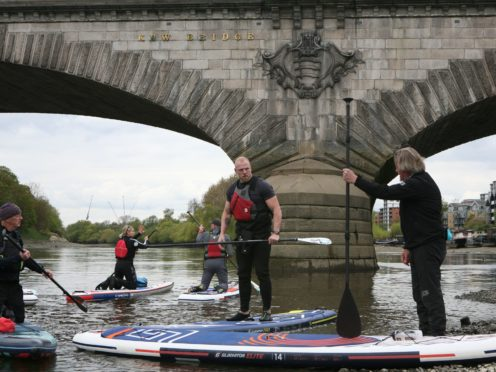 James Haskell, Charley Boorman, Dean Stockton and the training instructors prepare to start training on the River Thames (Luciana Guerra/PA)