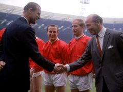 The Duke of Edinburgh greets Manchester United manager Matt Busby before the 1963 FA Cup final (PA)