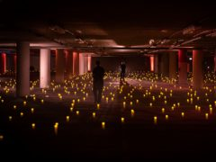 Battery-powered candles light the opera event in an underground car park in Chicago (Kyle Flubacker/Lyric Opera of Chicago via AP)