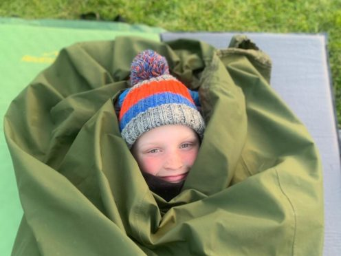 Archie Tunstill, aged eight, is to spend 100 nights sleeping in a bivvy bag in his garden in Suffolk for the Captain Tom 100 (Poppy Tunstill/PA)