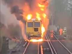 Firefighters battled in 'difficult conditions' to put out a blazing engineering train which caused a railway line to be closed (Network Rail/PA)