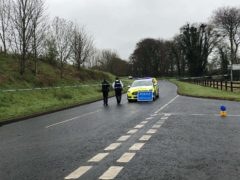 The scene of a security alert on the Ballyquin Road close to Dungiven, Co Londonderry after an explosive device was found close to the home of a member of staff of the PSNI (PA)