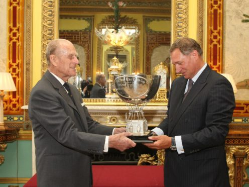 The Duke of Edinburgh presents the Aero Club Cup to David Hempleman-Adams, at a reception at Buckingham Palace, in central London in 2011 (Dominic Lipinski/PA)