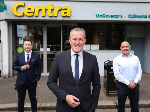 Finance Minister Conor Murphy (centre) pictured with Glyn Roberts, chief executive of Retail NI, and Donagh McGoveran, owner of Centra Cathedral Quarter, which will benefit from a £5,000 top-up grant. (William Cherry/Press Eye/PA)