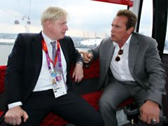 Boris Johnson with Arnold Schwarzenegger (PA)