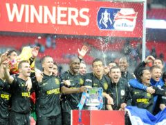 Wigan celebrate their FA Cup triumph in May 2013 (Anthony Devlin/PA)