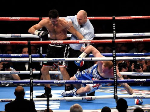 Carl Froch knocks down George Groves during the IBF and WBA World Super Middleweight title fight at Wembley (Adam Davy/PA)